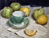 The green teacup with green apples and lemons by Elena Senatorova